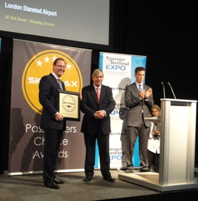 Nick Barton (left), Stansted's Managing Director, receiving the award from Edward Plaisted (middle), Chairman of SKYTRAX